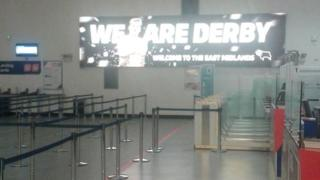 We Are Derby poster at East Midlands Airport