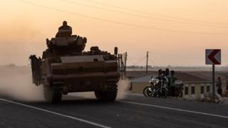 A Turkish tank heads for the border with Syria as Operation Peace Spring begins