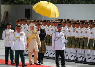 Sultan Muhammad V, third from left, inspects a ceremonial guard of honour during his welcome ceremony in Kuala Lumpur, Malaysia, Tuesday, 13 December 2016.