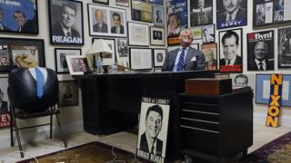 Roger Stone amid political memorabilia