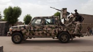 Nigeria army officers inside dia van.