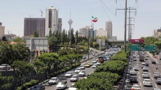 File photo shows a traffic jam in downtown Tehran on 27 April 2016