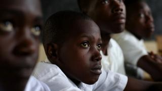 Boys participate in roundtable discussions to talk about ending gender-based violence in Rwanda.