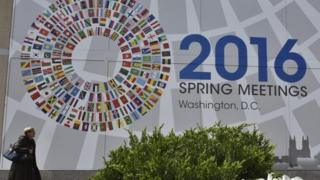 A sign announcing the 2016 spring meetings of the International Monetary Fund and World Bank