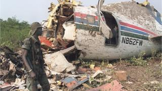 A Senegalese soldier looks at the wreckage of the Convair plane chartered jointly by the French tour operator Club Mediterranee and Air Senegal which crashed in Senegal's southern Casamance region 09 February 1992, killing 24 of the plane's 50 passengers and all six crew members.
