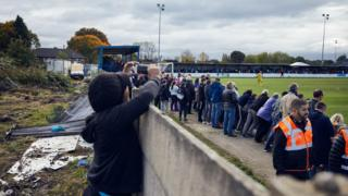 Boy taking a photo at Bury FC