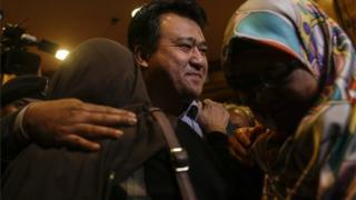 Mohd Nur Azrin Md Zin (C), one of the nine returning Malaysian nationals hugs his family members upon arriving at the Bunga Raya complex, Kuala Lumpur International airport in Sepang, Malaysia, 31 March 2017