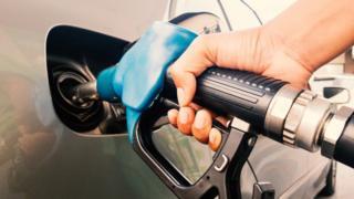 Petrol pump nozzle going into a car