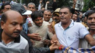 Hardik Patel, centre, after he was denied permission to hold a rally in Surat