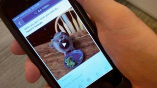 A smartphone displaying Facebook video
