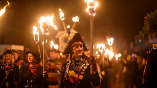 Bonfire societies parade through the streets during traditional Bonfire Night celebrations