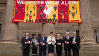 The Hillsborough victims' families, Prof Phil Scraton and Kenny and Marina Dalglish with their freedom medals