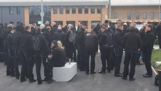 Officers gathered outside the cat