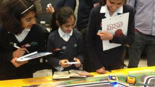 Young reporters from Plashet School looking at how the BBC Micro Bit can be used to programme toy cars