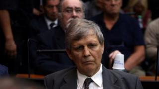 Former Argentine navy officer Afredo Astiz and other members of Argentina's Naval Mechanics School, known as the ESMA, where the military regime held and tortured thousands of leftists from 1976 to 1983, attend the sentence hearing of the five-year trial for their role during the 1976-1983 dictatorship in Buenos Aires,