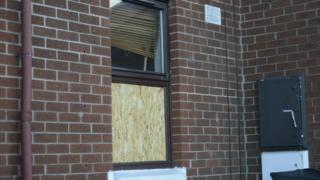 Broken window at house