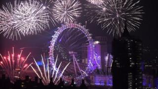 Fireworks explode over the London Eye