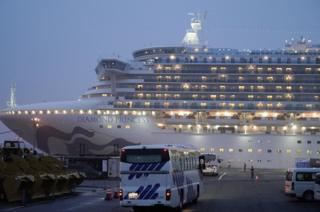 Buses parked close to the Diamond Princess cruise ship