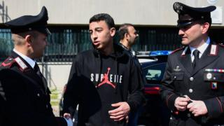 Ramy Shehata (C-R), who was able to call with his cell phone the Italian Carabinieri police for help during a schoolchildren hostage-taking situation on March 20 in San Donato Milanese