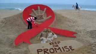 A sculpture by Indian sand artist Sudersan Pattnaik on the eve of World Aids Day on Golden Sea Beach in Puri, in Orissa state, on November 29, 2013