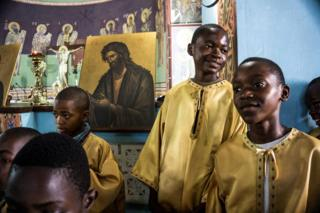 in_pictures Congolese altar boys of the Greek Orthodox Church attend a Sunday mass at the Saint Andrew Cathedral in Kananga.