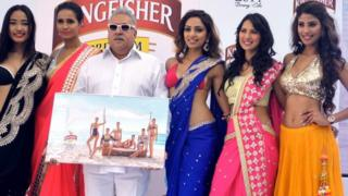 Vijay Mallya next to a line up of glamorous women