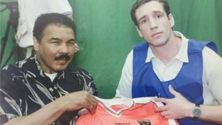 Armagh captain, Kieran McGeeney, presenting Ali with an Armagh jersey in 2005.