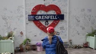 Technology A mourner pays respects on the third anniversary of the Grenfell tower fire