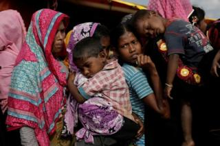 Rohingya refugees line up for a food supply distribution at the Kutupalong refugee camp near Cox's Bazar, Bangladesh. File photo