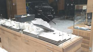 Car driven into shop