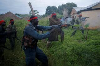 SPLA-IO (SPLA-In Opposition) rebels fire weapons during an assault on government SPLA (Sudan People's Liberation Army) soldiers in the town of Kaya, on the border with Uganda, South Sudan, 26 August 2017.