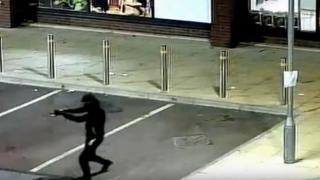 Man on CCTV holding gun