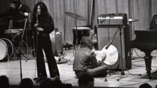 Yoko Ono and John Lennon on stage in Cambridge, March 1969