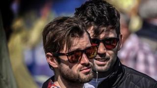 Two bearded men in sunglasses