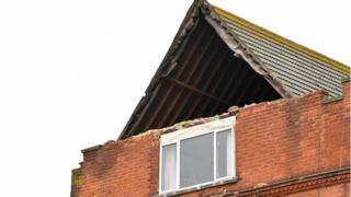 Exposed roof timbers are pictured after a part of building collapsed in Herne Bay, Kent