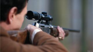 Man pointing rifle