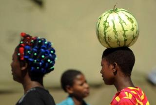 Water melon for head of young girl