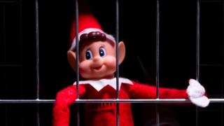 Naughty elf behind bars