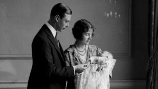 The Duke and Duchess of York with their eldest baby daughter Princess Elizabeth, now the Queen, at her christening. May 1926