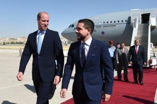 Prince William is welcomed by Jordan's Crown Prince Hussein bin Abdullah II