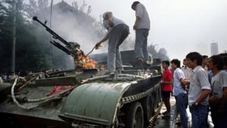 A burning APC on 4 June 1989 near Tiananmen Square