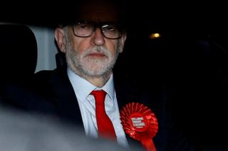 UK opposition leader Jeremy Corbyn leaves the Labour Party's headquarters following the general election in London