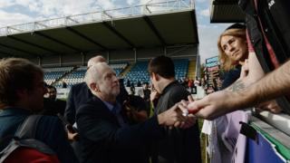 Jeremy Corbyn MP, greets his supporters during a rally at the Featherstone Rovers Rugby Stadium on 10 September 2016