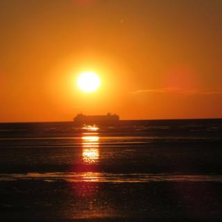 A ferry on the sea at sunset