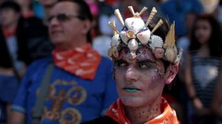 People take part in a demonstration to commemorate the U.N. International Day for the Elimination of Violence Against Women in San Jose, Costa Rica November 23, 2018