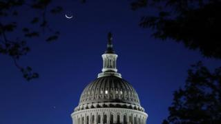 Moon over the US Capitol