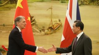 British Foreign Secretary Philip Hammond and Chinese Foreign Minister Wang Yi