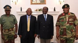 Mr Mugabe (second right) under house arrest, posing alongside Zimbabwe Defence Forces Commander General Constantino Chiwenga (right)