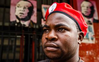 "A member of Zimbabwe's opposition party ""Movement for Democratic Change"" (MDC) stands outside Harvest House, the party's headquarters, in Harare on 15 February 15, 2018."