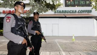Indonesian police officers stand guard at the site of the 14 January terrorist attack in Jakarta